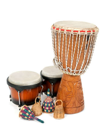 Percussion music instruments: djembe drum, bongos and caxixi shakers.