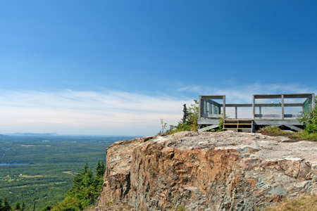 Touristic viewpoint on a cliff, beautiful view from a mountain. photo