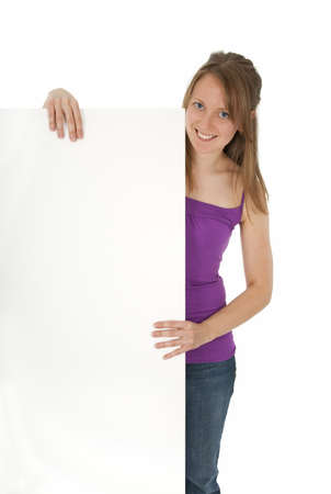 Casual young women holding a blank banner ad, smiling. Isolated on white. photo