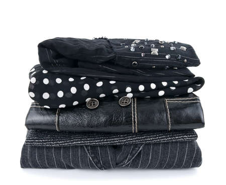 Stack of fashionable black clothes on white background. Stock Photo - 7814981