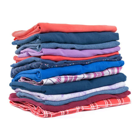 Stack of colorful casual clothes on white background.