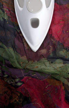 Ironing delicate fabric - colorful dark silk. photo