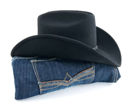 Men's wear - cowboy hat and blue jeans on white background.