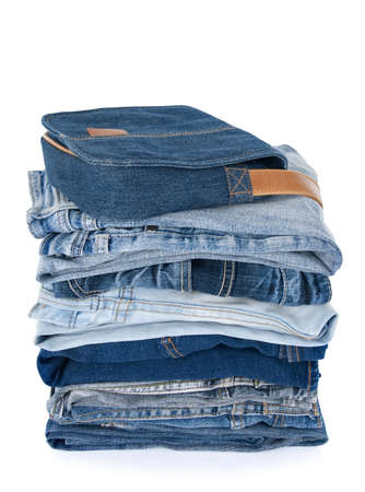 Stack of jeans and a denim bag on white background. Stock Photo - 7814991