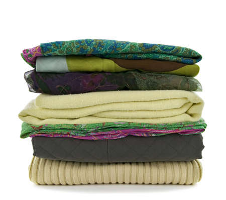 warm shirt: Pile of green casual clothes on white background.