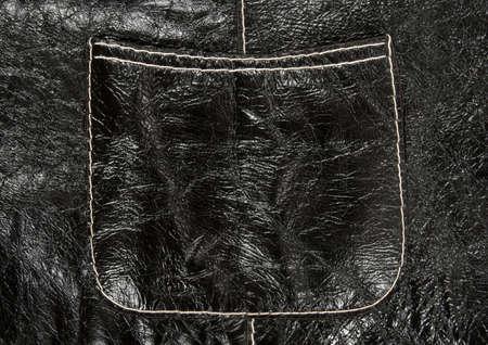 shiny black: Stitched pocket on shiny black leather clothing showing detailed texture. Stock Photo