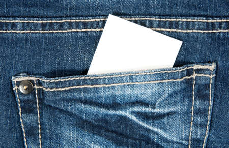 Blank card with copy space in a pocket of blue jeans. photo