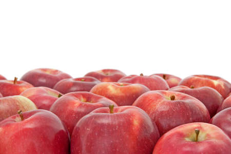 Many ripe red apples isolated on white background.