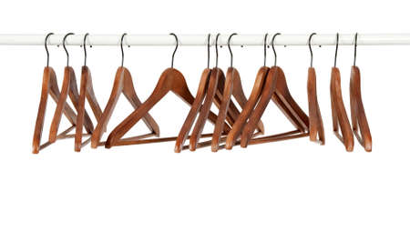 Many wooden hangers on a rod, isolated on white background.