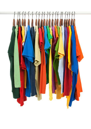 clothing rack: Variety of multicolored casual shirts on wooden hangers, isolated on white. Stock Photo