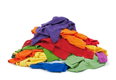 mess: Big heap of colorful clothes, isolated on white background. Stock Photo
