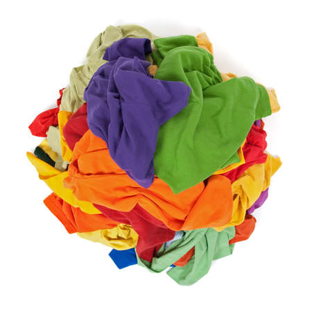 pile reuse: Big heap of colorful clothes, view from above, isolated on white background.