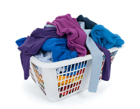 messy clothes: Bright clothes in a laundry basket on white background. Blue, indigo, purple.