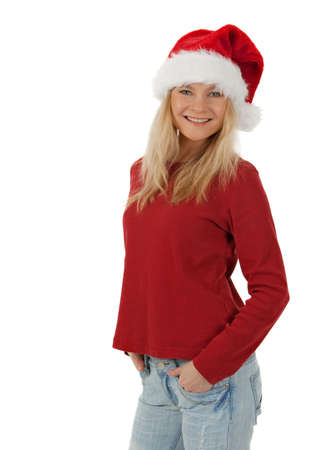 Smiling casual Christmas girl wearing Santa hat, isolated on white. photo