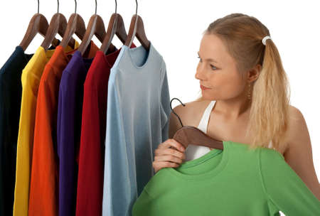 Young woman in a clothing store, choosing clothes to buy. photo
