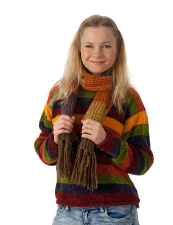 Smiling young woman wearing striped sweater and scarf, isolated on white. photo