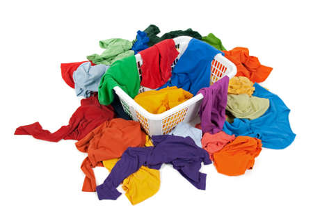 Bright messy clothes in a laundry basket and around it. Isolated on white background. Stock Photo - 8321739