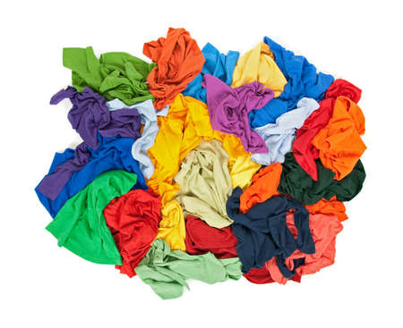 heap: Lots of messy colorful clothes, view from above, isolated on white background.