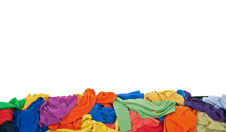 messy clothes: Messy colorful clothes border, isolated on white background, with space for text. Stock Photo