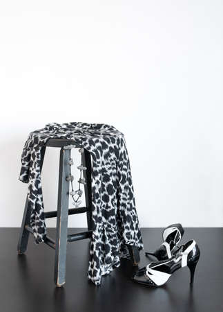 Black and white shoes and fashionable dress on old wooden stool. Stock Photo - 8763269