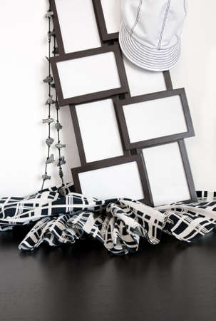 Black and white clothing and photo frames with copy space on wooden surface. photo