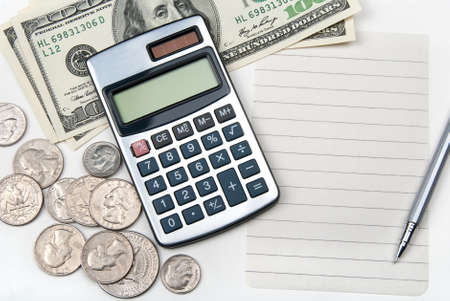 Calculator, money, pen and empty lined paper to white a shopping list. Stock Photo - 8985032