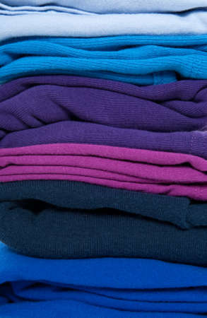 Background of folded blue, purple and indigo clothes. Stock Photo - 9071210