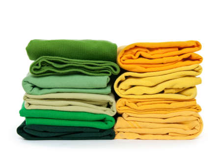 Spring colors. Fresh green and yellow laundry on white background. photo