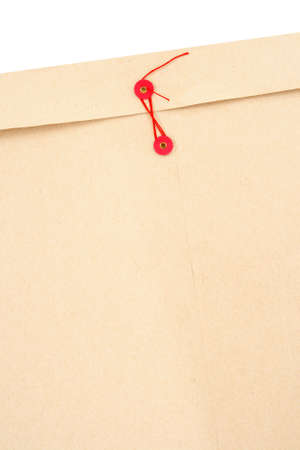 manila envelop: Manila office envelope with red string and space for text.