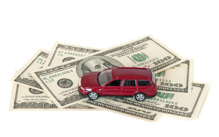 Red car and money, isolated on white background. Stock Photo