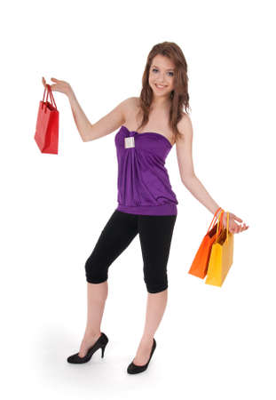 Pretty young girl with colorful shopping bags, isolated on white. 스톡 콘텐츠