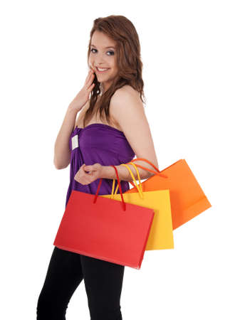 Cute girl holding colorful shopping bags, isolated on white. photo