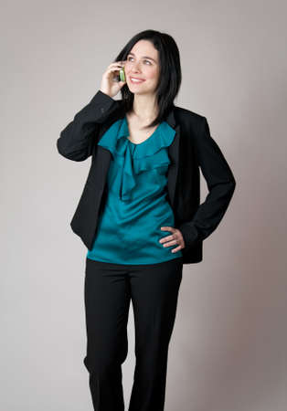 Business woman talking on the cell phone and smiling. photo