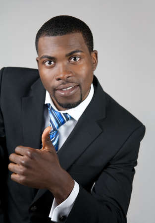 African American business man showing thumb up. Stock Photo