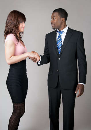 formal clothing: African American business man meeting a female colleague.