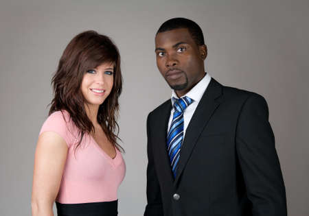 Young business partners, Caucasian woman and African American man. Stock Photo - 9455358