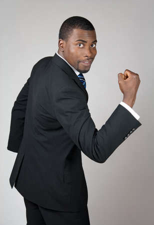 African American business man showing his strength.