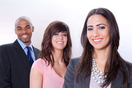Happy multiracial business team, three young smiling people. Stock Photo