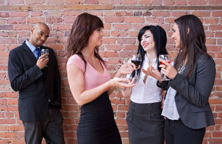 Guy looking at girls drinking wine and having fun. Stock Photo - 9609408