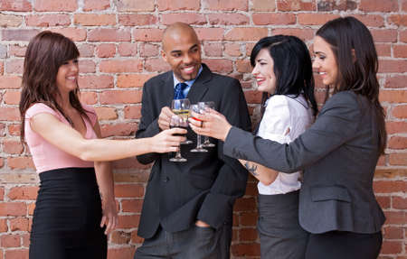 Cheers! Young people drinking wine, chatting and having fun. Stock Photo - 9609405