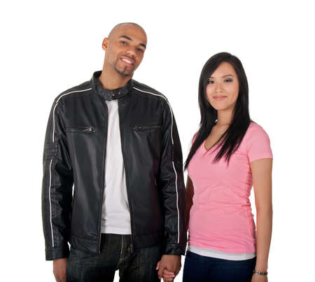 asian afro: Young couple holding hands - African American guy with Asian girlfriend.