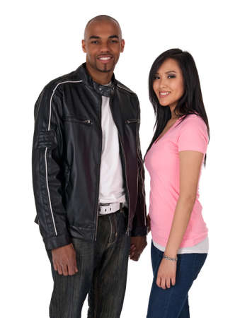 Smiling couple holding hands - African American guy with Asian girlfriend. photo