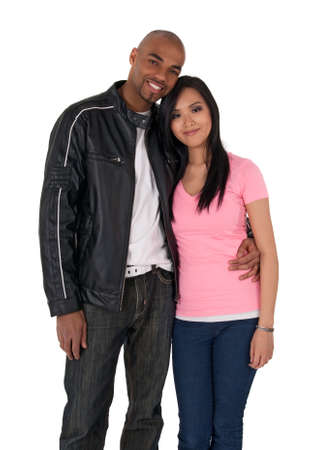 Young affectionate couple hugging - African American guy with Asian girlfriend. photo