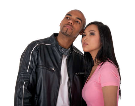 Young couple looking into the future - African American guy with Asian girlfriend. photo