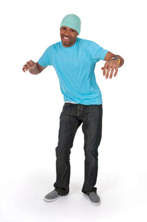 Funny guy in a blue t-shirt dancing, isolated on white background. photo