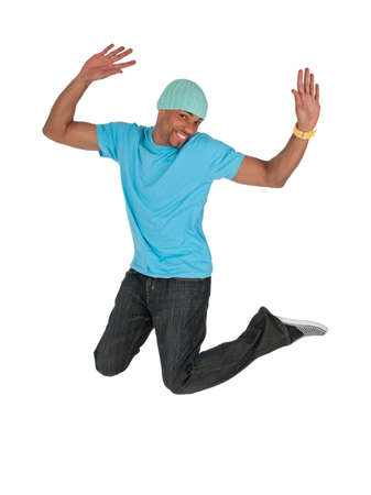 Smiling guy in a blue t-shirt jumping for joy, isolated on white background. Stok Fotoğraf