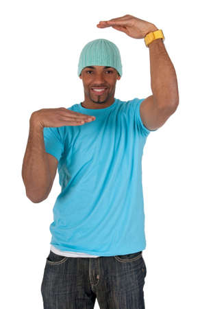 multi race: Young guy in a blue t-shirt making a frame with his arms. Isolated on white background. Stock Photo