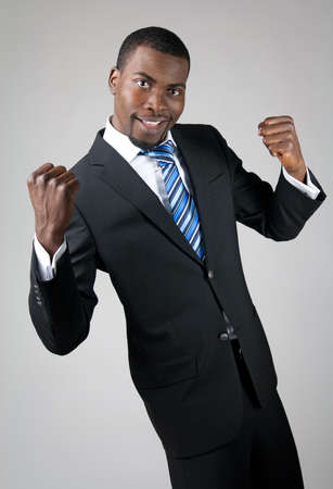Smiling handsome African American businessman showing his strength. 版權商用圖片