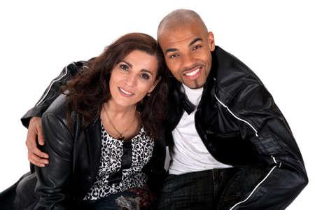 multi race: Feliz pareja multicultural sonriendo. Mujer madura con joven.