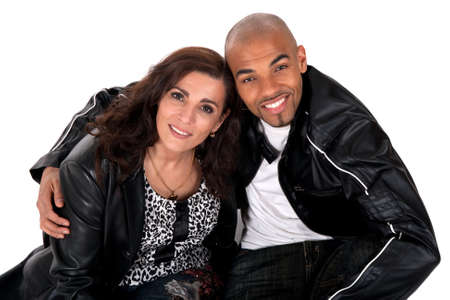 Happy multicultural couple smiling. Mature woman with younger man. Stock Photo